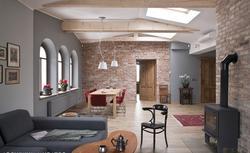Działowa ściana z cegły - budować ją przed wylewką podłogi?